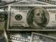 A pile of $5, $10, $20, $100 bills