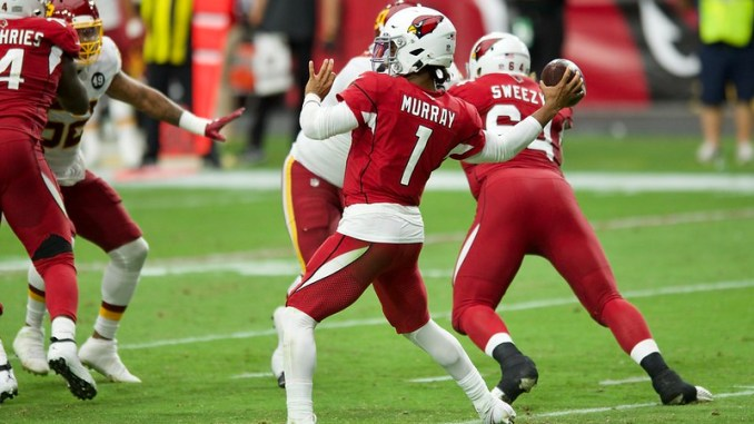 NFL Arizona Cardinals quarterback Kyler Murray playing throwing a pass against the Washington Football Team