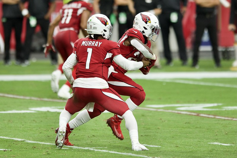 Arizona Cardinals running back Chase Edmonds taking a handoff from quarterback Kyler Murray in a football game