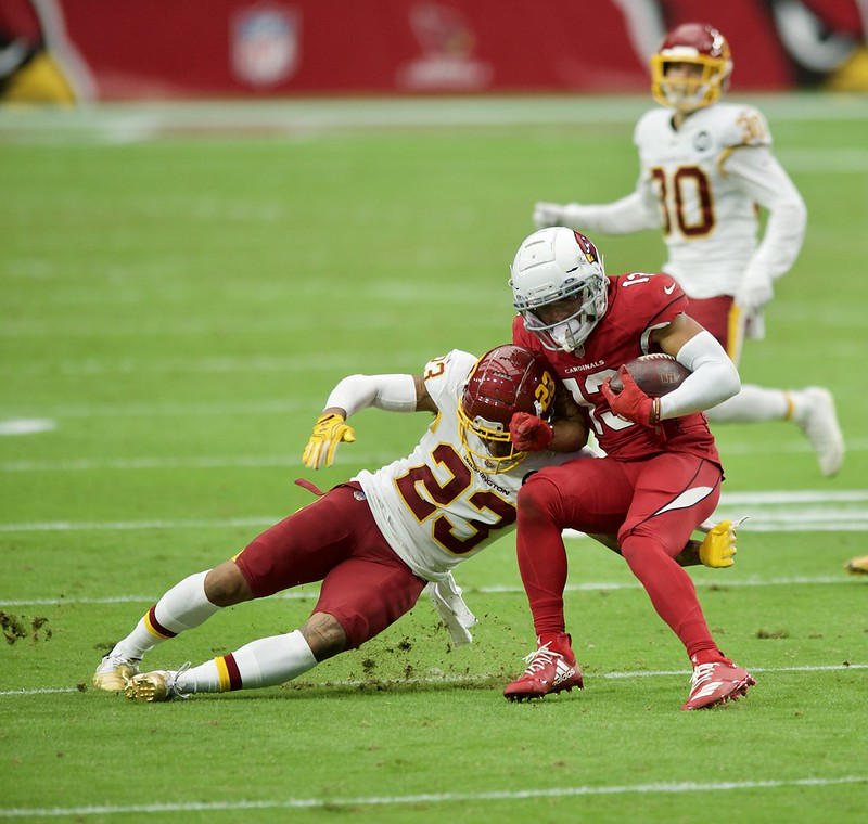 NFL Arizona Cardinals wide receiver Christian Kirk getting tackled by a Washington Football Team defensive player