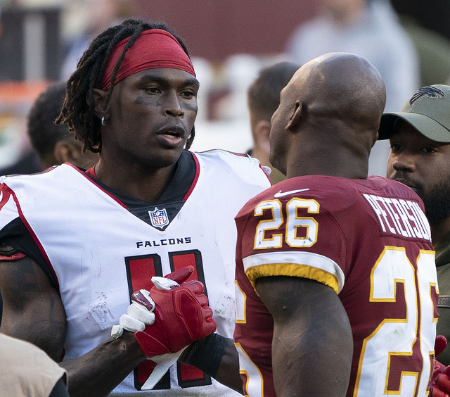 NFL Atlanta Falcons wide receiver Julio Jones shaking hands with running back Adrian Peterson