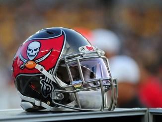 A NFL Tampa Bay Buccaneers helmet sitting on the sideline