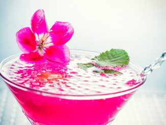 The Beach Please Martini is a bright fuchsia cocktail bursting with island flavors of guava rum & coconut.