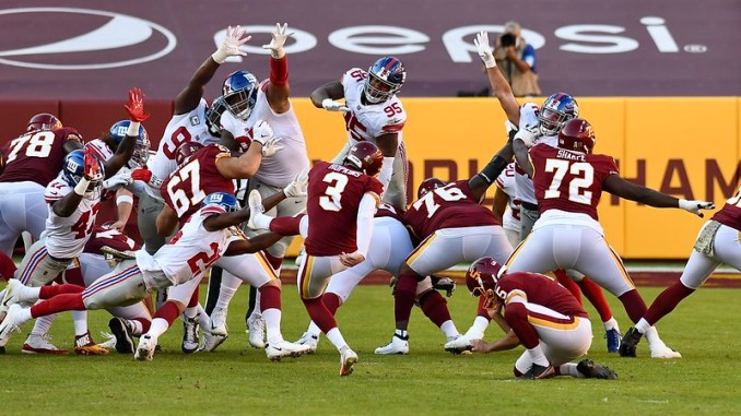 The Washington Football Team kicker Dustin Hopkins attempting a field goal against the New York Giants.