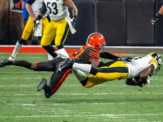 Pittsburgh Steeler wide receiver out stretched catching the football in a game against the Cleveland Browns