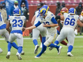 Los Angeles Rams quarterback Jared Goff handing off the football to running back Cam Akers