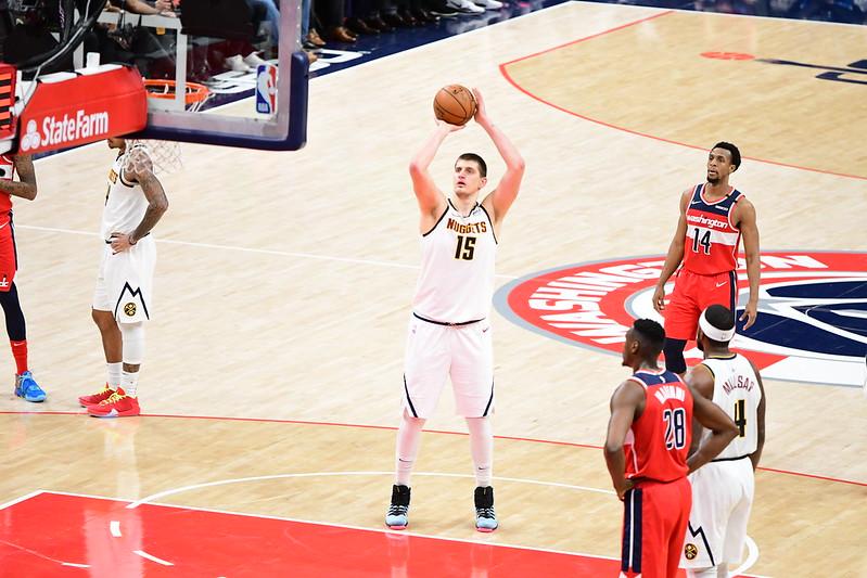 NBA Denver Nuggets center Nikola Jokic shooting a free throw against the Washington Wizards.