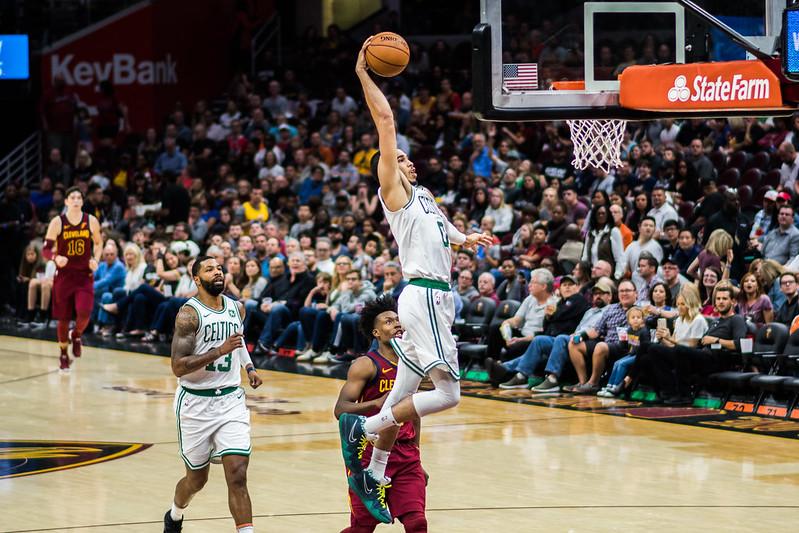 NBA Boston Celtics power forward Jayson Tatum dunking the basketball.