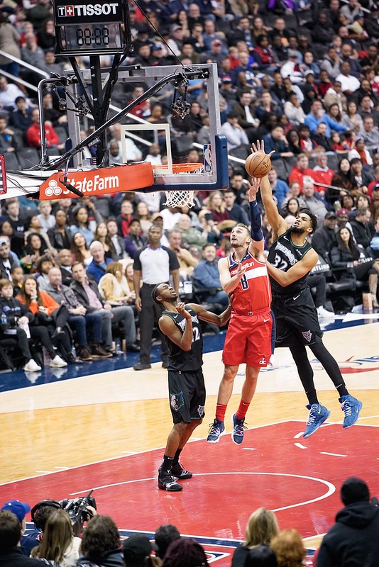 NBA Minnesota Timberwolves center Karl-Anthony Towns blocking a shot against the Washington Wizards.