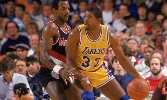 NBA legendary Los Angeles Lakers point guard being guarded by Portland Trail Blazers Clyde Drexler.