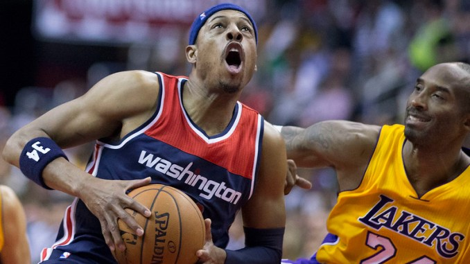 """Washington Wizards small forward Paul """"The Truth"""" Pierce driving to the basket against defender Los Angeles Lakers Kobe """"The Black Mamba"""" Bryant."""