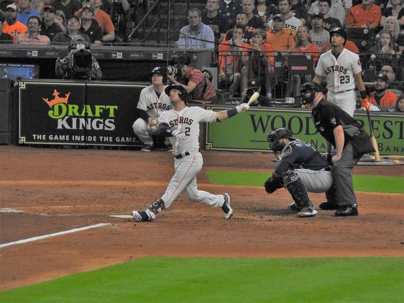 MLB Houston Astros third baseman Alex Bregman up at bat swinging at a pitch.