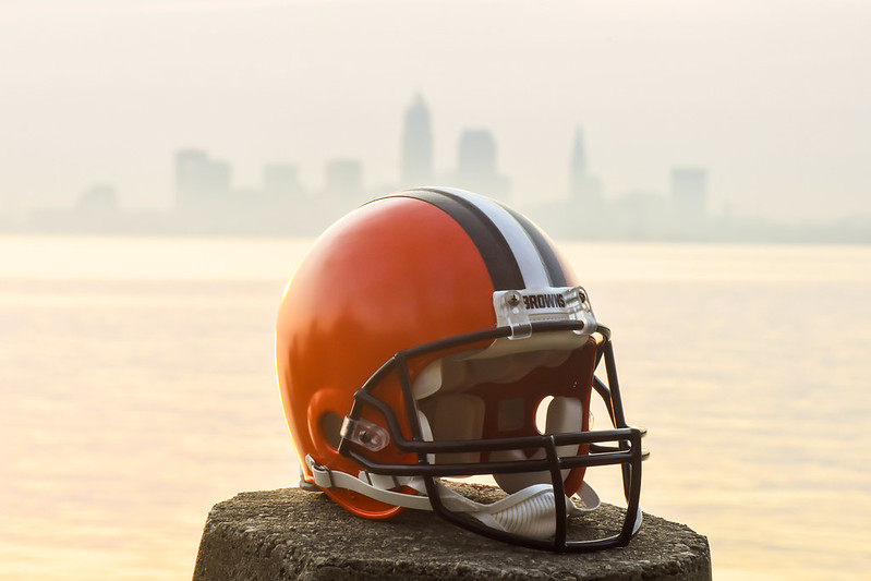The NFL Cleveland Browns helmet in front of lake Erie and the city of Cleveland skyline.