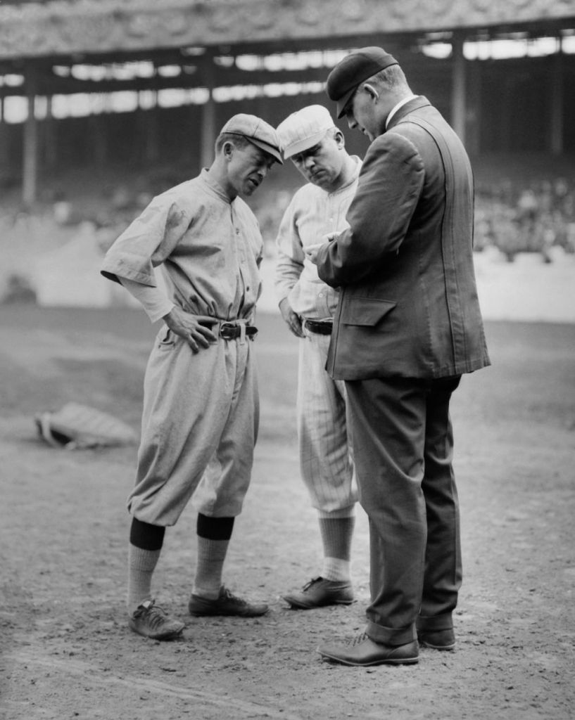 Managers John McGraw and Miller Huggins with an umpire.