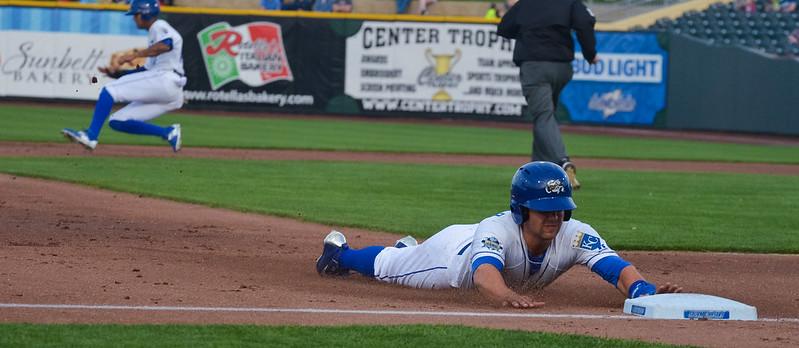 Kansas City Royals right fielder Whit Merrifield stealing a base.