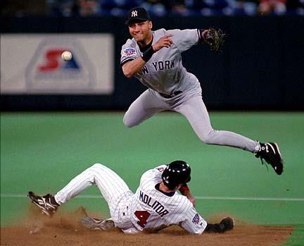 Legendary Yankees shortstop Derek Jeter fielding the baseball.