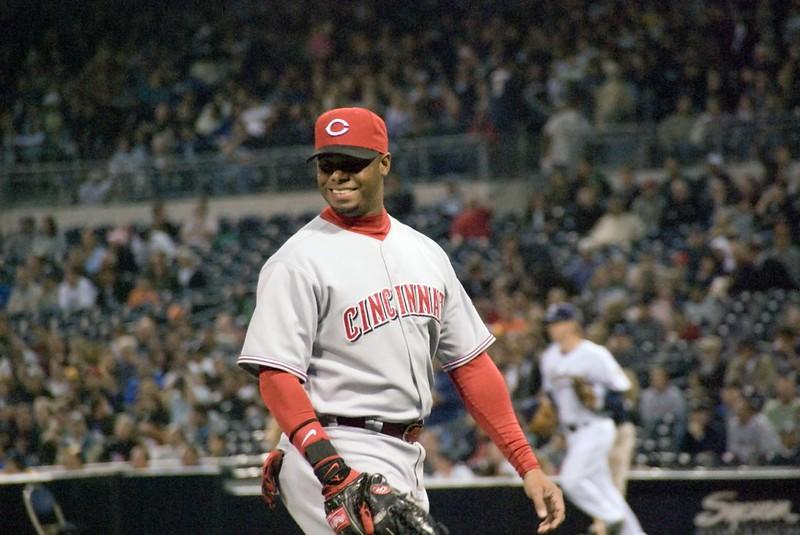 Cincinnati Reds star player Ken Griffey Jr. smiling on the baseball field.
