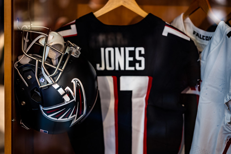 Julio Jones Atlanta Falcons jersey and helmet hanging up in the NFL Experience locker room at the 2021 NFL Draft in Cleveland, Ohio.
