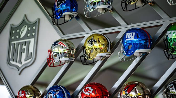 A collection of NFL helmets at the 2021 NFL Draft Experience in Cleveland, Ohio.