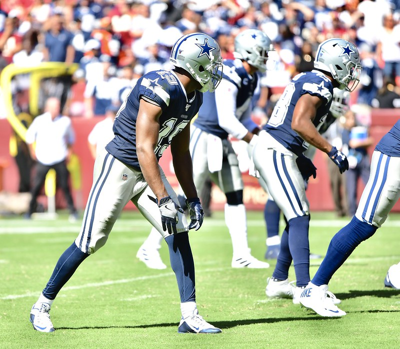 Dallas Cowboys wide receiver Amari Cooper lining up for a play in a football game.