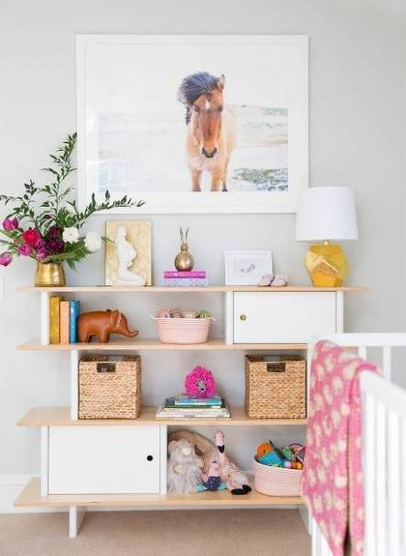 20-kid-room-shelves-with-styling-you-ll-want-to-copy-kids-room-design-pink-and-white-kids-room-with-bookshelf-cubbies-580fac66eeb90a08340c5d6d-w620_h800