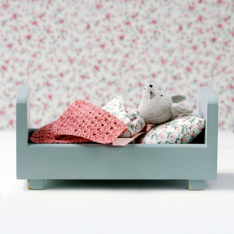 Wooden miniature bed, toy for kids.