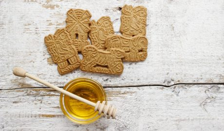 Speculaas biscuits on rustic wooden table