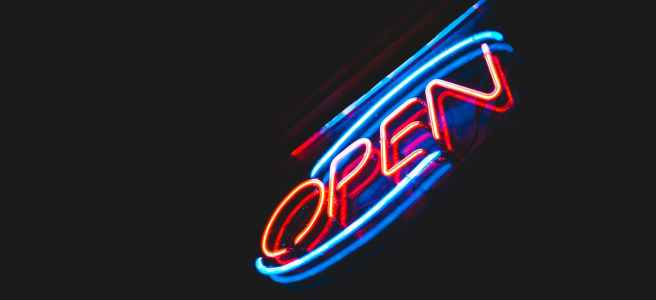 open neon sign against night sky