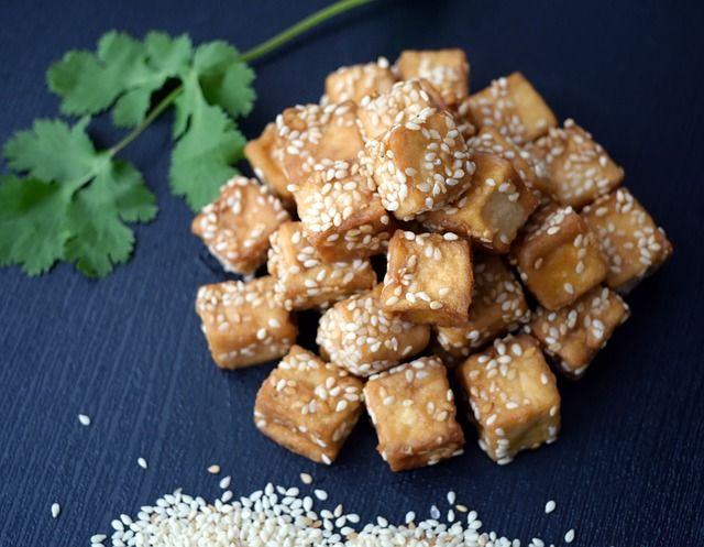 Tofu is easy to use, vegan, and high in protein.