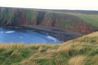 The cove with the stacks forming the Thirle Door to the far left