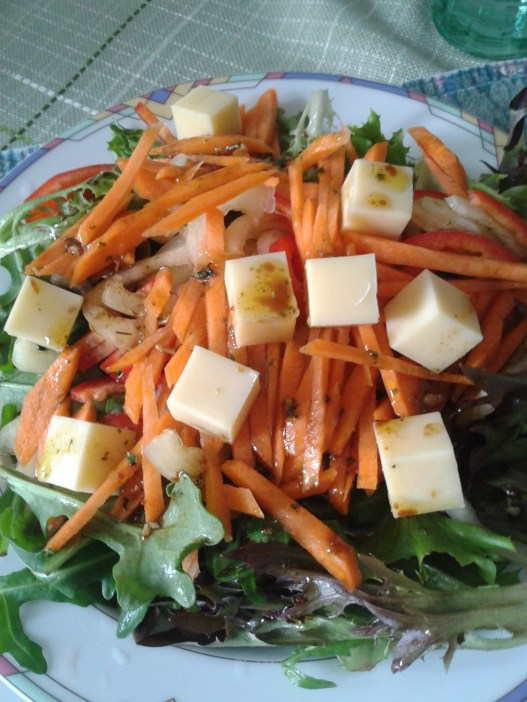 salad with ruccola, carrots, cheese, balsamic vinegar and olive oil