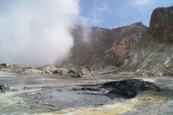 The mudpools are just below boiling point. In the background you can see the main crater steaming.