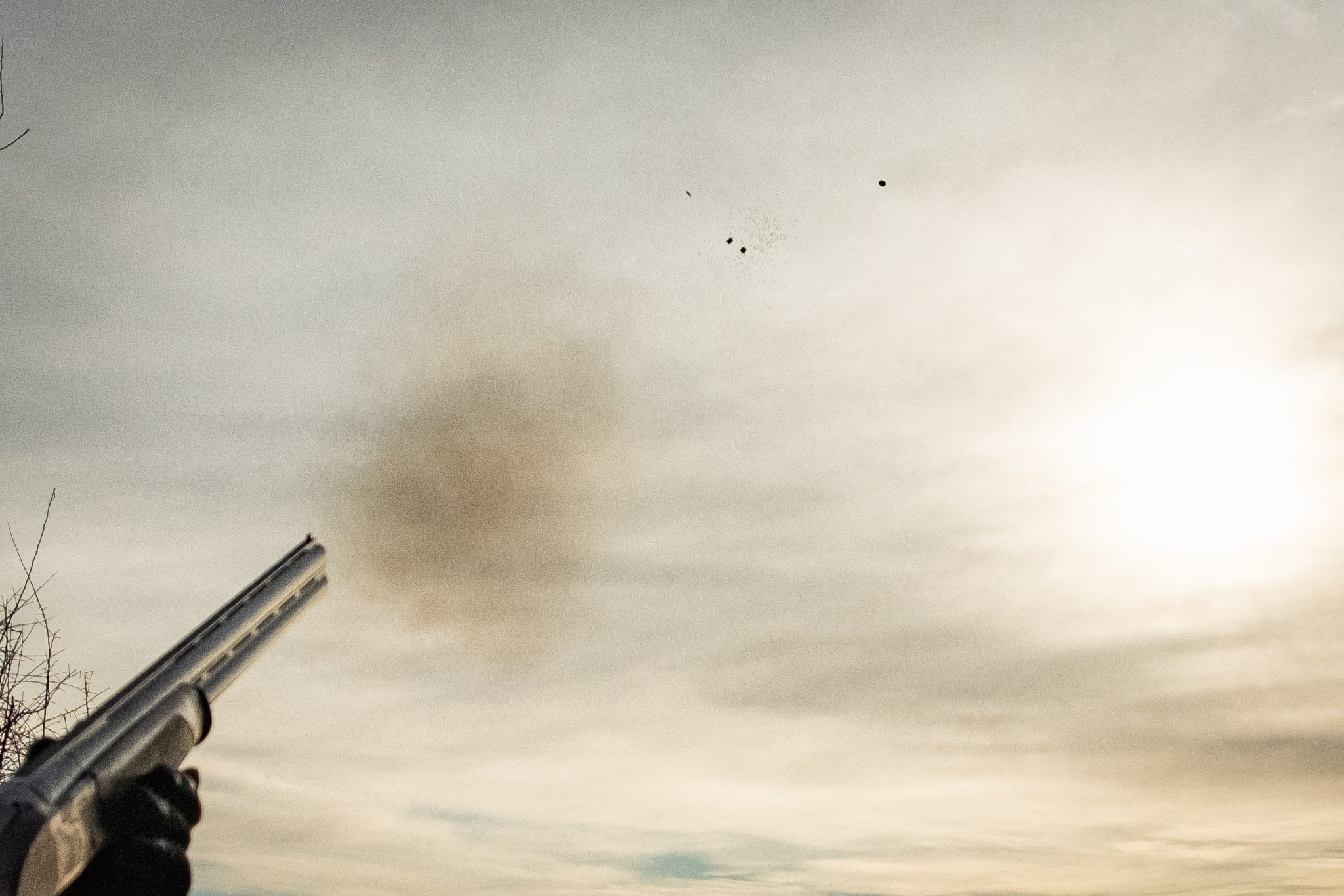 A clay pigeon breaking in midair