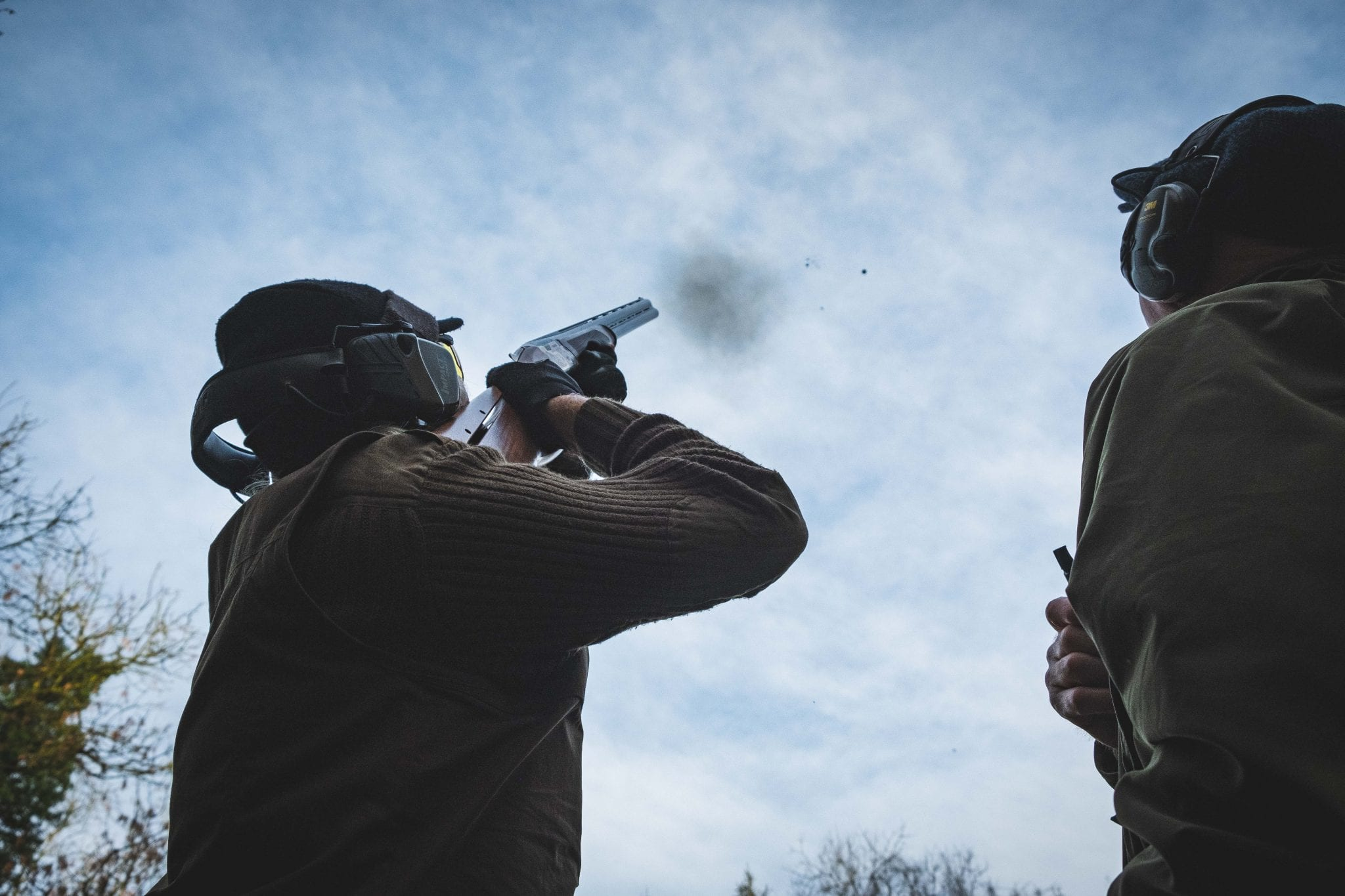A customer clay pigeon shooting with an instructor at Lady's Wood
