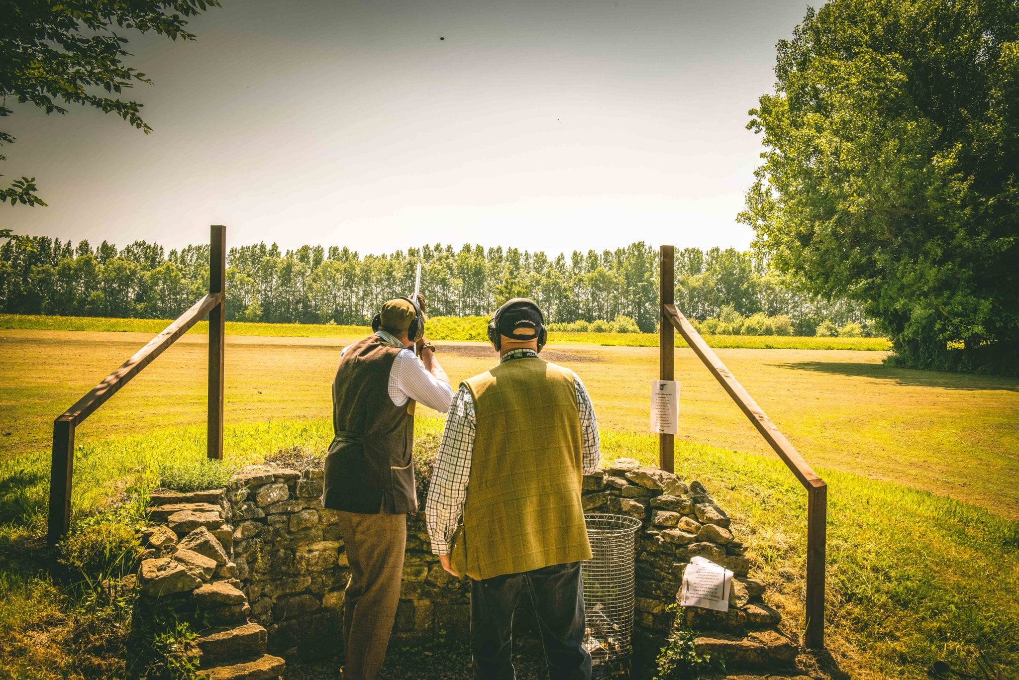 A customer shoots the grouse butt on a game shooting lesson at Lady's Wood