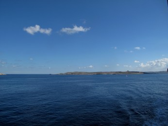 On the very left - piece of Gozo, in centre - Comino, on the very right far away - Malta.