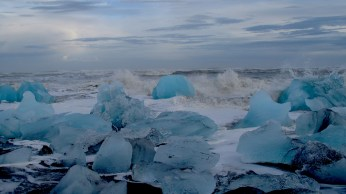 Ocean waves and crystall blue icebergs