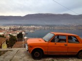 Lake Ohrid and old-school car. By the way, Macedonian streets are fool of such automobiles..
