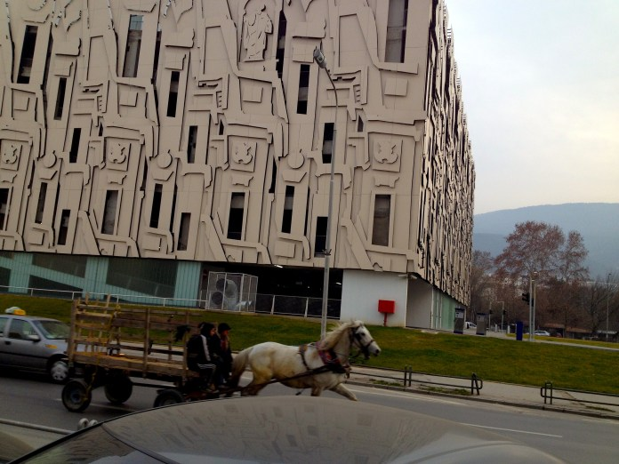 Modern and artistic parking and horse carriage in the busy street...