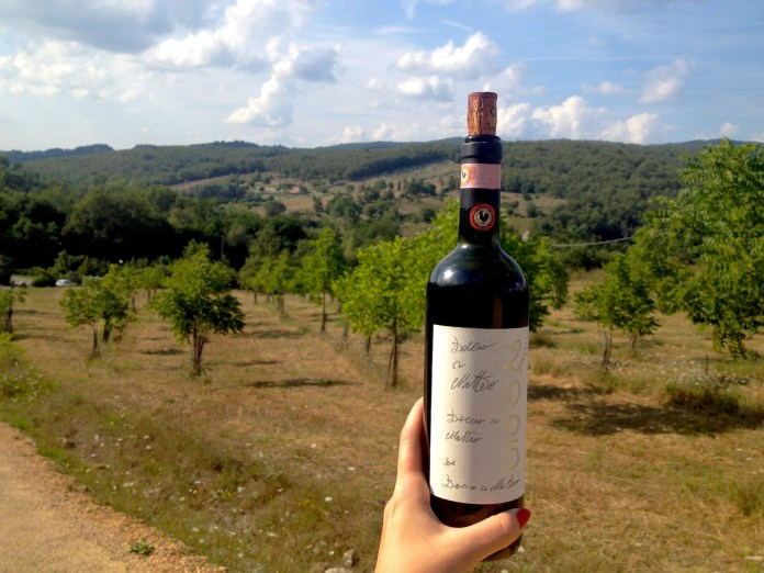 "A still life with ""Chianti Classico"" wine and the landscape of Tuscany. The bottle, produced in ""Caparsa"" winery, to take away.."