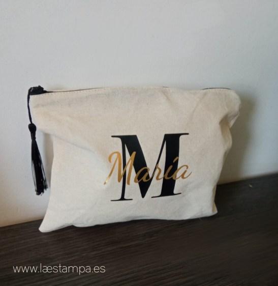 conjunto bolsa y neceser inicial dorado