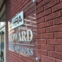 Howard-Risk-advisors aluminum on acrylic sign