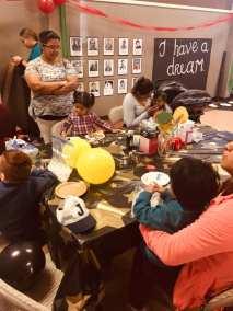 la familia gathering with kids