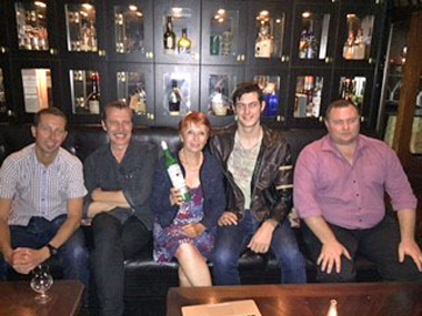 Marie-Claude Delahaye with Think spirits team in Sydney with a bottle of la Fée absinthe