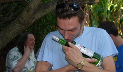 Man kissing a bottle of La Fée absinthe