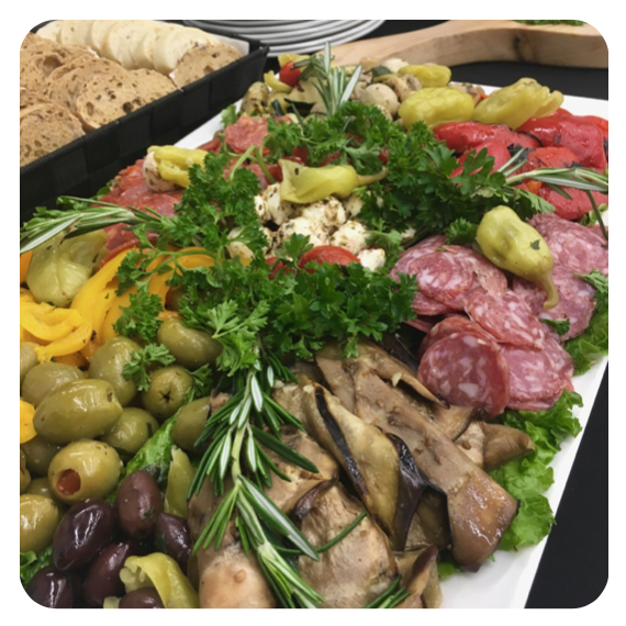 Italian antipasto platter topped with fresh parsley