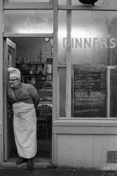 Brick Lane cafe owner. East London England, 1974. ©Homer Sykes/Courtesy Les Douches la Galerie
