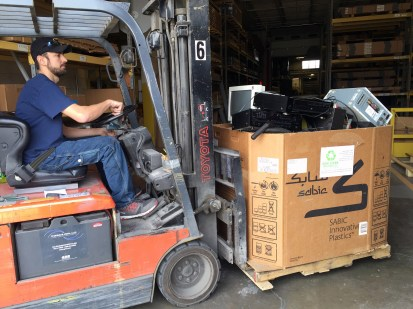 Steve helps move the first full box of items to recycle.