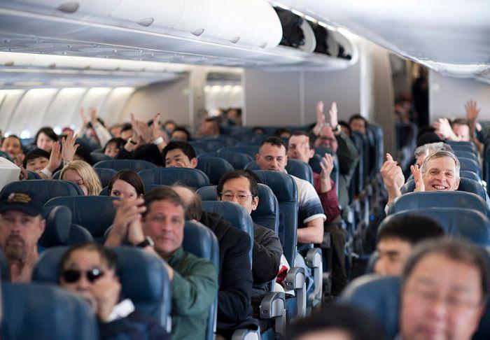 File:110312-F-NW653-143 Passengers aboard a Delta Air Lines flight.jpg