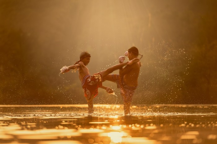 water silhouette cloud sunrise sunset photography sunlight morning river reflection splash training asia exercise boxer thailand fight boxing power men children sports boys photograph fighting attack image the sun laos traditional kick hero punch thai boxing kickboxing martial arts knock the game men's
